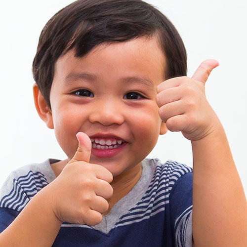 Little boy holding a thumbs up at a Preschool & Daycare Serving El Cajon, Lakeside and Santee CA